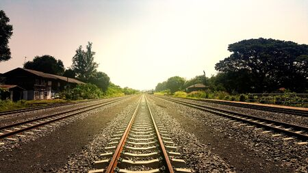 The countryside railway tracks in Thailand stretch along the path to the next destination