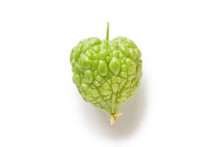 Heart shaped bitter gourd fruit isolated on white