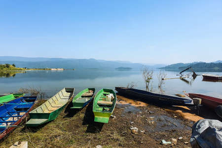 Rowing boats stranded in the reservoir where the water level began to decline in the dry season. Reklamní fotografie