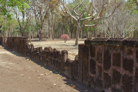 Ancient wall made of laterite at Kamphaeng Phet Historical Park