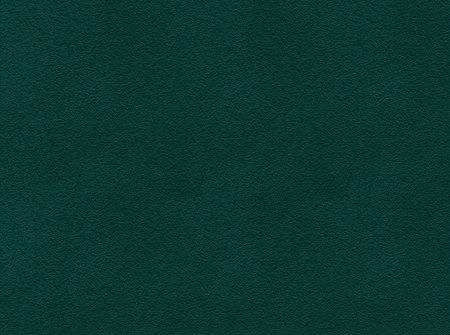 Dark green painted wall with rough surface texture background.