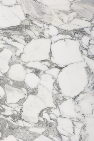 Closeup white marble with natural pattern texture background.