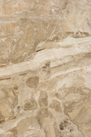 Closeup beige marble with natural pattern texture background.