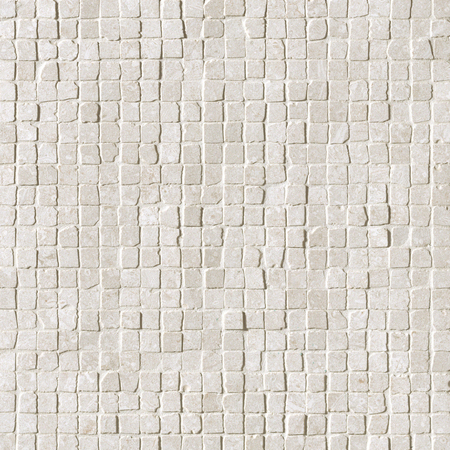 Raw-looking stone white mosaic tiles texture background.