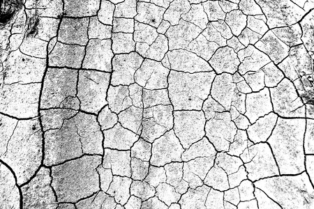 Abstract dirty dark grunge background. Monochrome cracked earth texture. Effect the black and white tones.