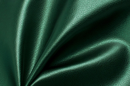 Green eco leather. Artificial leather. Synthetic leather. Leatherette background.