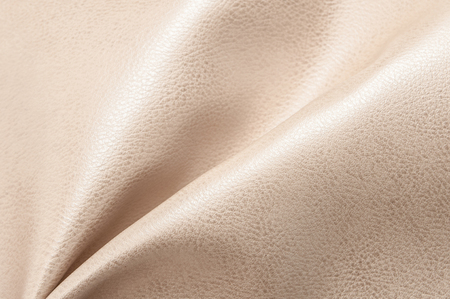 Beige eco leather. Artificial leather. Synthetic leather. Leatherette background.