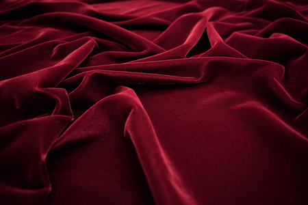 Dark red velvet fabric texture background. 写真素材