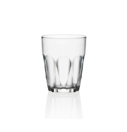 Empty shot glass isolated on white background. Side view.