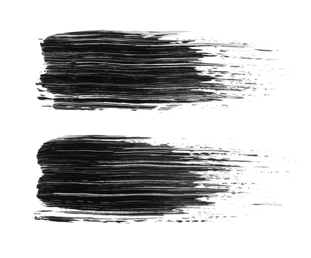 Two black acrylic brush strokes isolated on white background. Abstract handmade drawing brush lines.