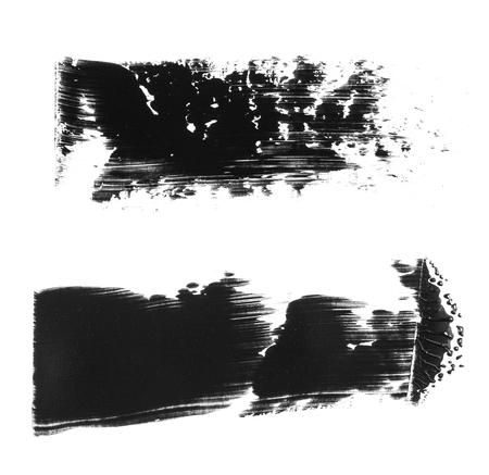 Two black acrylic strokes isolated on white background. Black brush drawing element.