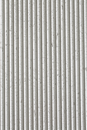 Old white ribbed concrete surface texture background. Vertical picture.