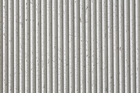Old white ribbed concrete wall texture background. Horizontal picture.