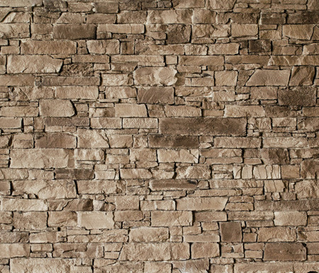 Grey stone wall with rough surface texture background.