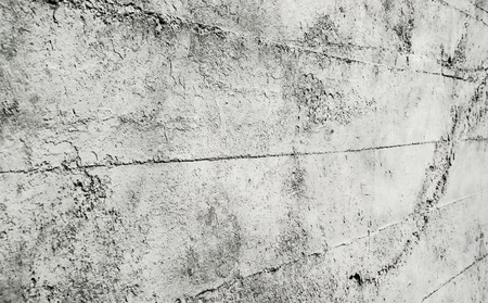 Grey concrete wall with stains texture background.. Angle view.
