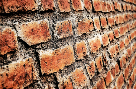 Red brick wall texture background. Angle view.