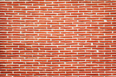 Red brick wall with narrow blocks texture background. Imagens