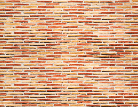 Red and yellow brick wall texture background. Imagens