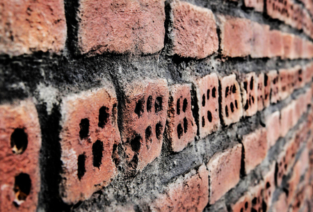 Rustic red brick wall texture background. Angle view. Imagens