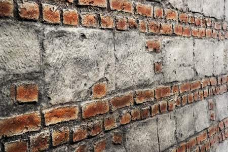 Decorative rustic red brick wall texture background. Angle view.