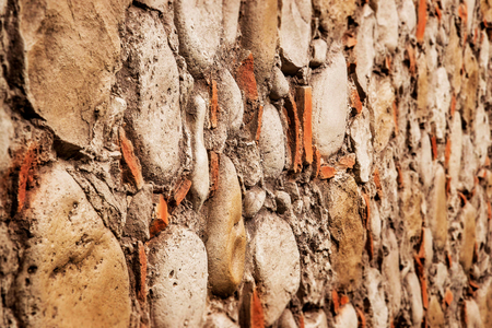 Closeup stone wall texture background. Angle view. Imagens