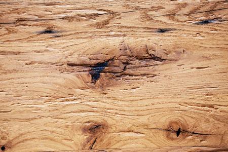 Closeup oak wooden board texture background. Imagens