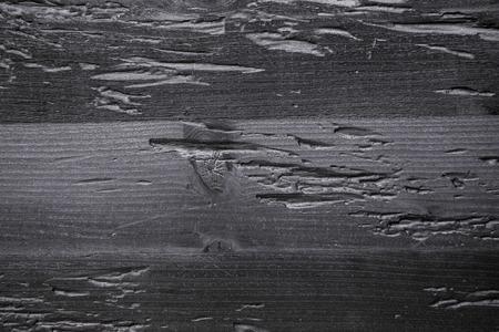 Closeup decorative black charred wood board texture background.