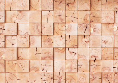 Square wooden mosaic tile wall with uneven surface. Imagens