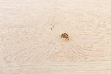 Light brown maple wood surface with natural pattern texture background.