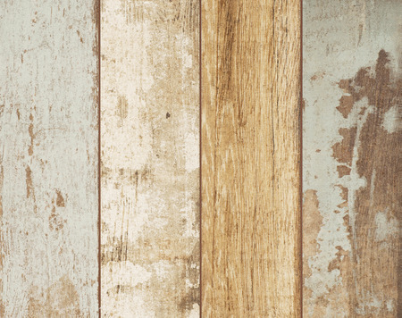 Old dry dirty shabby wooden boards with peeling paint texture background.