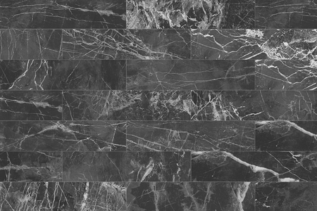 Black rectangle marble wall tile texture background. Imagens