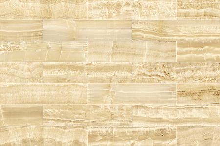 Beige rectangle marble wall tile texture background.