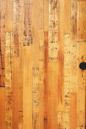 Old dry lacquered oak wooden boards texture background.