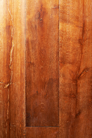 Old lacquered oak wooden boards texture background.