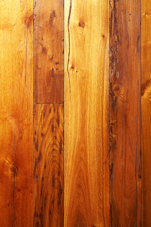 Old dry lacquered wooden boards texture background.