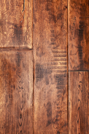 Old brown lacquered oak wooden boards texture background.