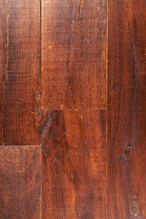 Dry brown lacquered oak wooden boards texture background. Imagens