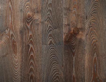 Dark brown maple wooden boards texture background.