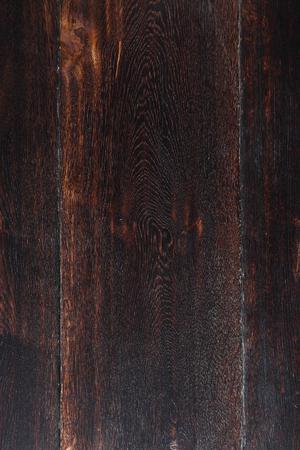 Closeup dry dark brown oak wood floor boards texture background. Imagens