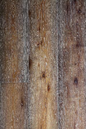 Closeup old dark brown oak wood floor boards texture background.