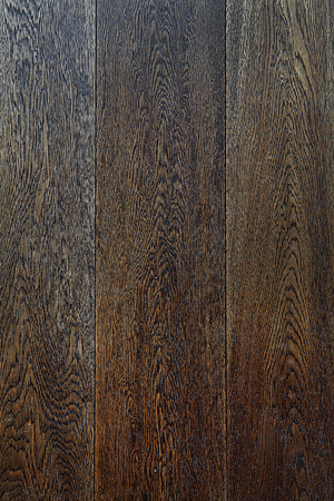 Dark brown oak wood floor boards texture background.