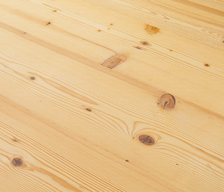 Brown maple wood floor boards texture background. Angle view.