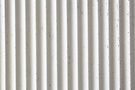 Old white ribbed concrete wall texture background.