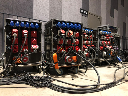 Electric power distribution boxes with power and signal cables. Installation of professional equipment for a concert. Imagens