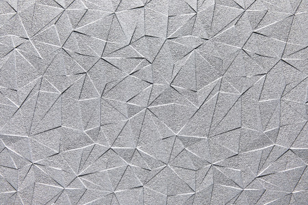 Grey silver steel surface with abstract triangle pattern texture background. Imagens