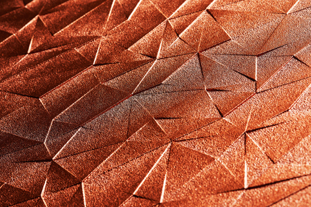 Red gold steel surface with abstract triangle pattern texture background. Angle view. Imagens