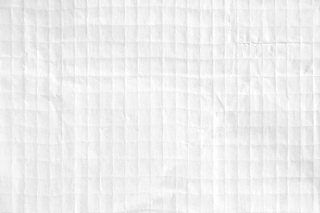 Closeup white crumpled checkered sheet of paper texture background.