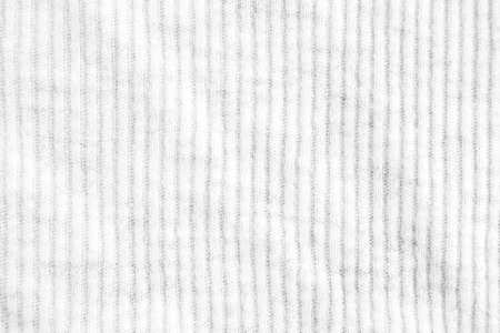 Closeup white crumpled striped and ribbed fabric texture background.