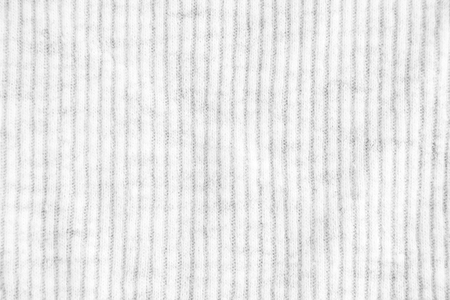 Closeup white crumpled striped and ribbed textile texture background.