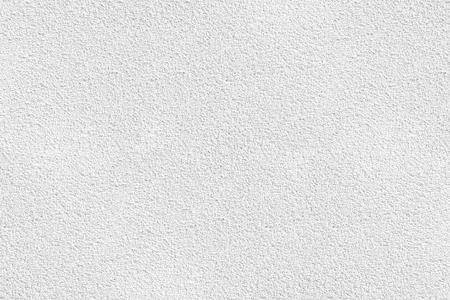 White stucco wall texture background. White plastered and painted wall with rough surface.
